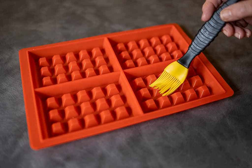 Greasing-a-silicone-waffle-mold-How To Grease A Waffle Iron Without Spray